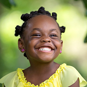 Young girl smiling.